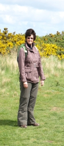 Ruth with bright gorse bushes on Norfolk coastal walk
