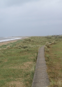 Leaving Caister along the sea wall - Ruth's coastal walk