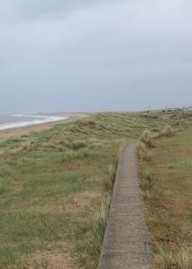 Leaving Caister along the sea wall - Ruth's coastal walk