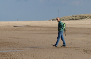 My husband walking to meet me on Sea Palling beach, Ruth's coastal walk