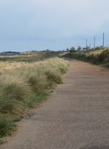 Ruth's coastal walk: road beside beach, leading to Caister-on-Sea