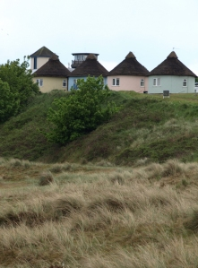 Thatched round cottages, Winterton-on-Sea, Norfolk coast part of Ruth's coastal walk.