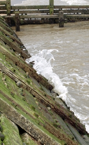 Waves hitting the wooden sea defences, near Mundesley, Ruths coastal walk