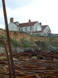 Abandoned house, on cliff at Happisburgh - coastal erosion on Ruth's coastal walk in Norfolk