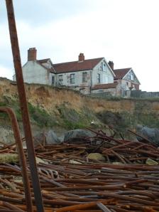 Abandoned house, on cliff at Happisburgh - coastal erosion on Ruth's coastal walk in Norfolk