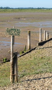 Swimmers bathe at their own risk, sign, Hamford Marshes, Essex