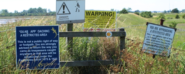 Signs warning of explosives - Ruths coastal walk UK