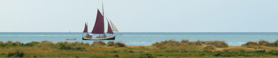 Red sailed ship, Jaywick beach.