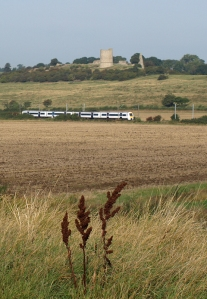 View of castle on ridge, and train. Ruth's coastal walk, Essex.