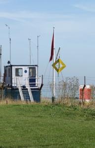 Yellow sign on Shoeburyness beach, Ruths coastal walk, Essex