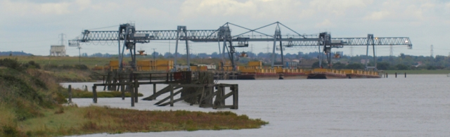 Old jetties with cranes, Mucking Tip, Essex. Ruths coastal walk.