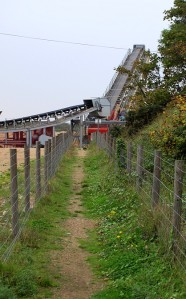 Path going under gravel conveyor belt, Kent, Ruth's coastal walk