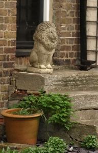 Lion guarding a doorstep, Upnor, Medway, Ruth's coastal walk.