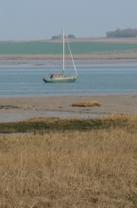 Boat and Isle of Sheppey beyond. Ruth's coastal walk.