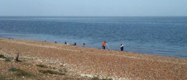 father and son fishing, near Whitstable, Kent. Ruths coastal walk.