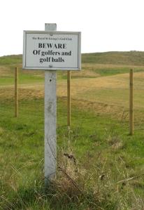 Golf course warning sign, Ruth's coastal walk. Sandwich.