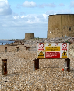 Martello tower guarding entrance to range, Hythe. Kent.