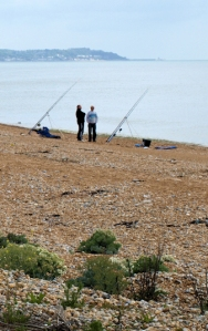 Fishermen near Dymchurch Redoubt, Ruths coast walk, Kent.