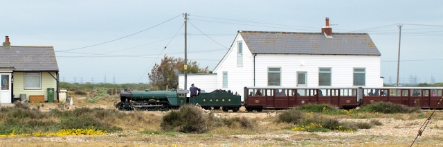 Train going through Dungeness, Ruths coastal walk.