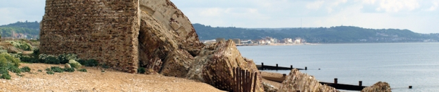 Crumbling Martello tower, Hythe beyond. Ruth's coastal walk.