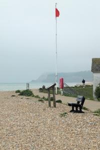 Red flag on Winchelsea Beach, Ruth's coastal walk.
