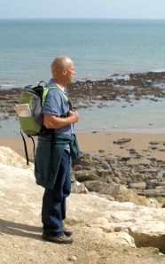 John contemplates climbing down to the beach, Ruth's coast walk.