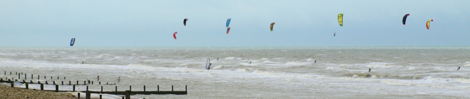 HEADER - kite surfers and wind surfers, Camber Sands, Ruth's coast walk.