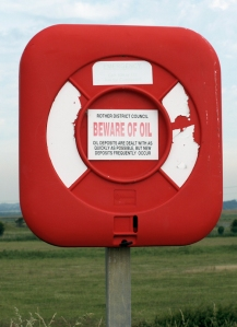 sign about oil, Norman's Bay, Sussex. Ruth walks round the coast.