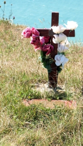 Memorial at Beachy Head, cross and flowers, Ruth's coastal walk.