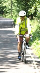husband on bike, ruth walks around the coast