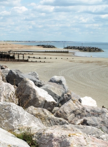 2 - Looking back to Littlehampton, breakwaters. Ruth on coast walk through Sussex.