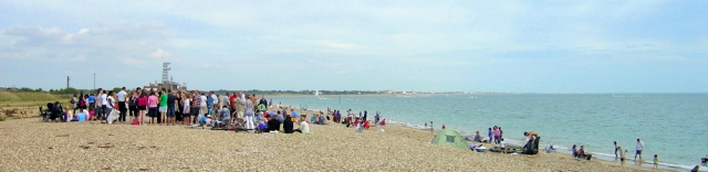 South Portsmouth beach - group of people, Ruth walks around the coast