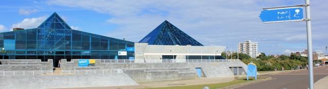 new development, Pyramids Centre, Portsmouth. Ruth walking round the coast.
