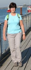 Ruth on coastal walk - ferry pier at Christchurch