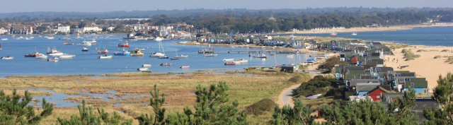 looking back to Christchurch Harbour, Ruth walking round the coast