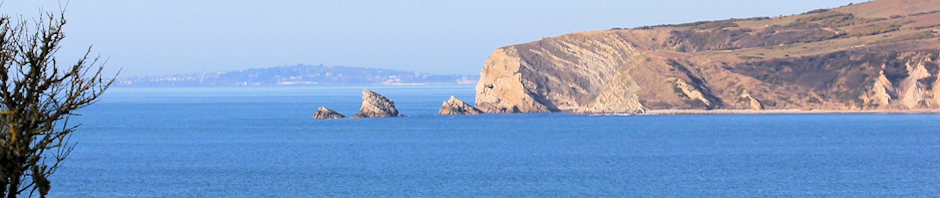 header, view of Mupe Rocks, Weymouth beyond.