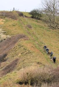 Walking up Houns-Tout Cliff, Kimmeridge, Ruth walking the South West Coast Path, Dorset.
