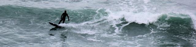 surfer, off Kimmeridge Ledges, Ruth on her coastal walk in Dorset