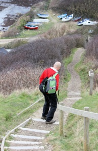 down to Kimmeridge Bay, John carrying rucksack for Ruth on her coastal walk.