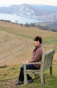 Ruth, sitting on top of hill, Kimmeridge, South West Coast walk.