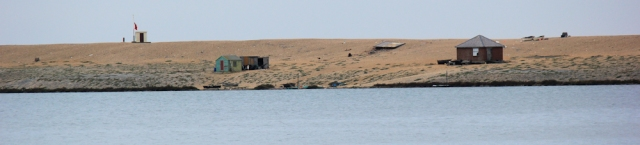 Chesil Beach and warning post, Ruth on coastal walk round Dorset