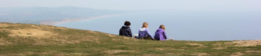 top of Golden Cap, Dorset, Ruth walking round the coast.