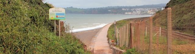 Red Rock Beach, looking towards Dawlish, Ruth walking round the coast in Devon
