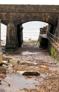 under railway bridge, Dawlish, Ruth on her coastal walk