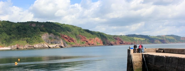 view across Babbacombe Bay, Ruth walking the coastline of the UK