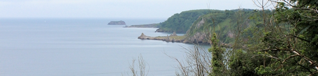 view from Petit Tor Point, to Long Quarry Point, Ruth on her walk around the coast, Devon