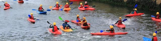 kids in kayaks, Brixham, Ruth walking the coastline
