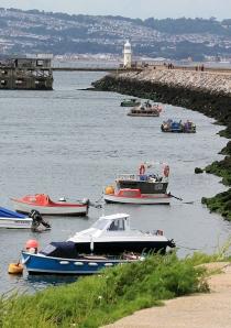 Brixham Breakwater, Torbay, Ruth on her coast walk.