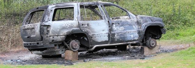 Burnt-out car, Brixham, Ruth on her walk around the coastline