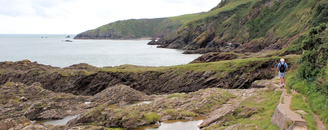 rounding Blackstone Point, Ruth walking the South West Coast Path